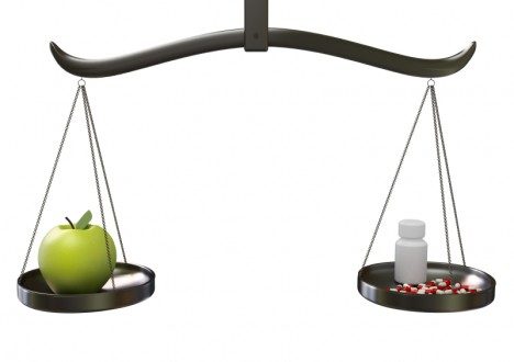 Scale balancing fruit and medicine
